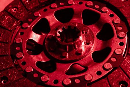 Disc brake rotor close-up, red color overlay.