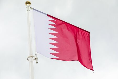 Katar flag waving in the wind against sky