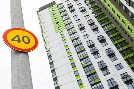 Ground view of european roadsign Speed limitation forty against highrise Stockfoto