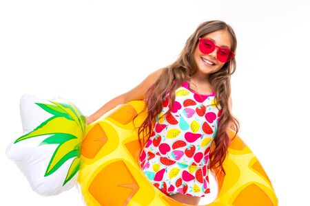 happy child on summer vacation, girl in a swimsuit with a wide smile on her face