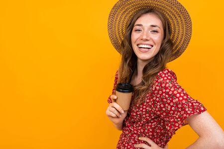 Cheerful european woman laughs on an orange