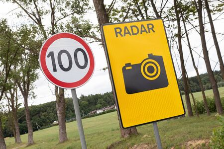 Roadsign Speen limitation one hundred km and tablet with radiolocator.