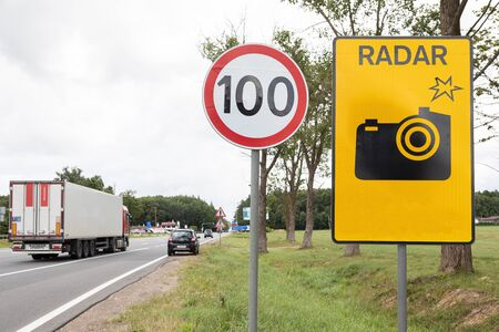 Roadsign Speen limitation one hundred km and tablet with radar gun.