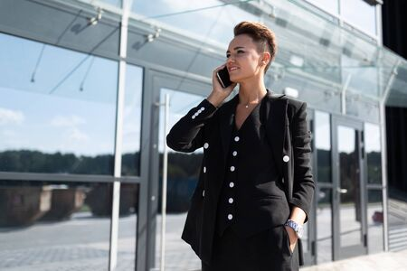 portrait of a successful businesswoman on the background of a skyscraper