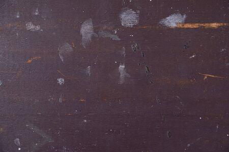 Scuffed darkbrown wooden plaque, interior texture
