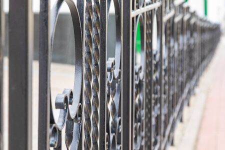 Wrought black iron balustrade of bridge, depth of field photo Stock fotó