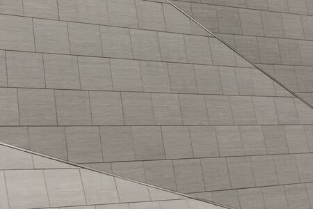 Close-up of grey concrete tiled wall. Three shades of gray on ceramic surface Banque d'images - 133063614