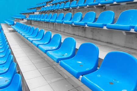 Low angle view of empty spectator seats at sport facility for international competitions. Stock Photo