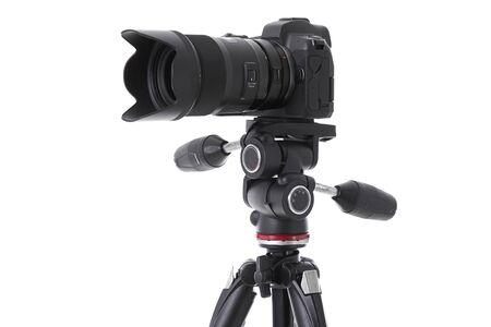 Side-view of professional camera device on holder isolated. Photo with depth of field