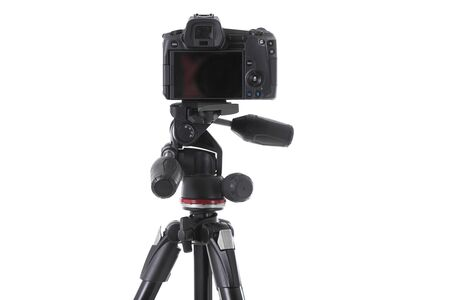 Backside view of modern multifunctional black camera on holder isolated Foto de archivo