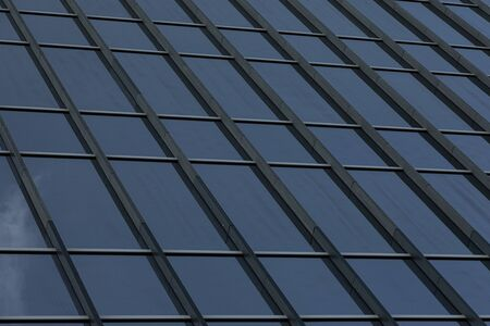 Angular view of modern glass business centre wall Stock Photo