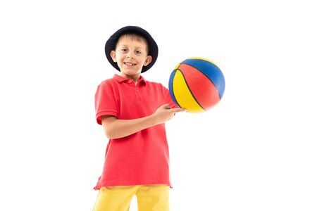 Caucasian teenager boy play basketball, picture isolated on white background. Banco de Imagens