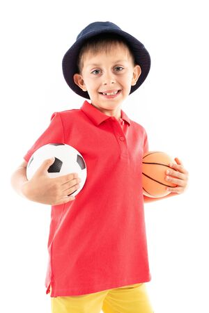 Caucasian teenager boy with basketball and soccer ball, picture isolated on white background. Banco de Imagens