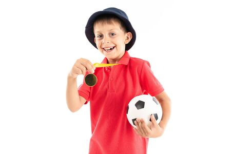 Caucasian teenager boy winner of soccer competition, picture isolated on white background. Banco de Imagens - 133679349