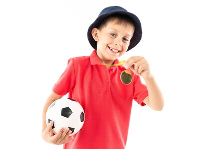 Caucasian teenager boy winner of soccer competition, picture isolated on white background. Banco de Imagens - 133679350