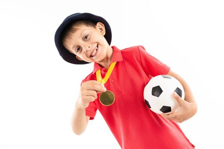 Caucasian teenager boy winner of soccer competition, picture isolated on white background.