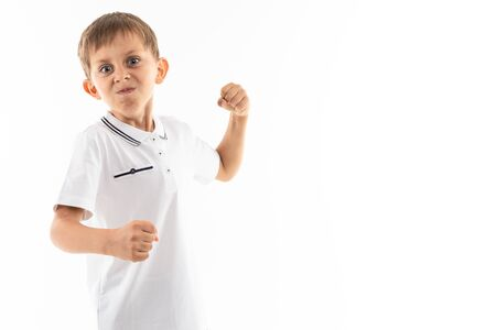 A little caucasian boy is angry and want to fight. Banco de Imagens - 133679355