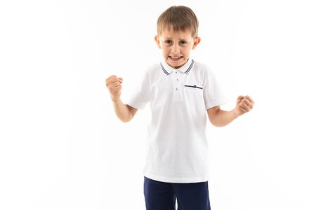 A little caucasian boy is angry and want to fight. Banco de Imagens