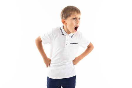 Portrait of a little caucasian boy is screaming.