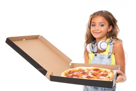 Teenager with pizza in hand on a white isolated background Reklamní fotografie