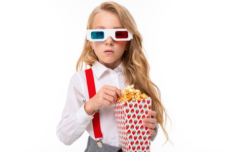 European stylish in glasses for a movie theater with popcorn in hand on a white background.