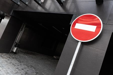 Road sign stop in front of building.