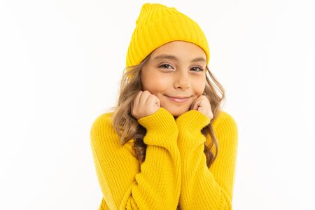 cute young girl tells smiling on a white studio background. 스톡 콘텐츠