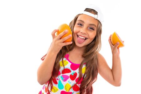 Teenager caucasian girl in swimsuit, red sunglasses with fruits isolated on white background
