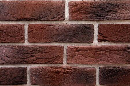 close-up of a reddish antique brickwork front panel.