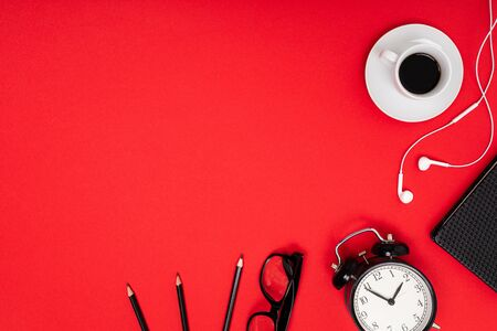 office workplace. watches, glasses and pencils on a red table with copy space. Banco de Imagens