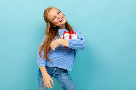 valentines day concept. girl with a gift on a light blue background.