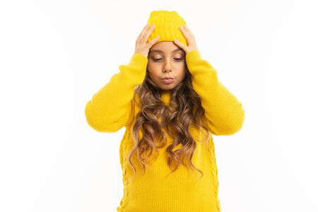 Happy caucasian girl in yellow hat and hoody is surprised isolated on white background.