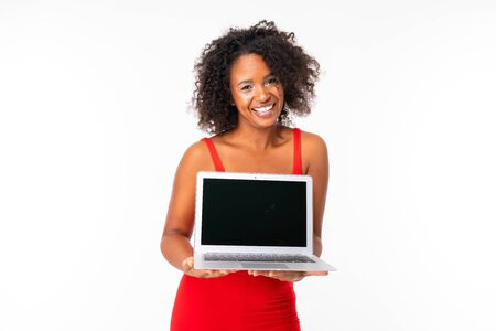 african girl shows a laptop display with a mockup on a white background. Banco de Imagens