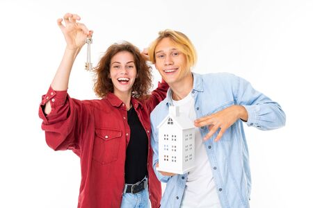 happy couple of young family women and men receiving apartment keys on a white background.. Banco de Imagens