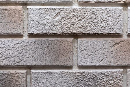 close-up of a light gray brick wall.