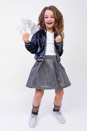 stylish girl with dollar bills on a white background.