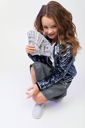 cute stylish girl won money in a draw on a white background.