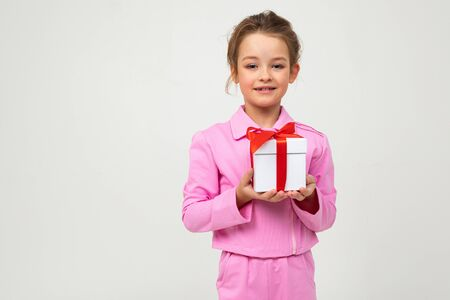 surprised joyful happy girl received a birthday present on a white background with copy space. Imagens