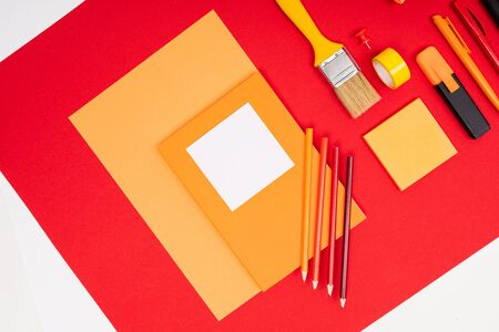 design concept. stationery and brush with paper on a red background.