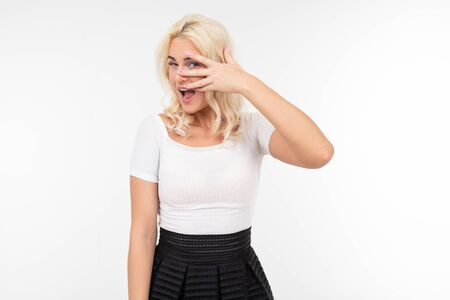 girl flirts building eyes on white background with copy space.
