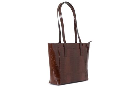 leather female brown bag on the handle sideways on a white background.