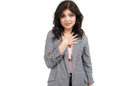 girl in a classic checkered gray jacket apologizes for the inconvenience on a white background. Stock Photo