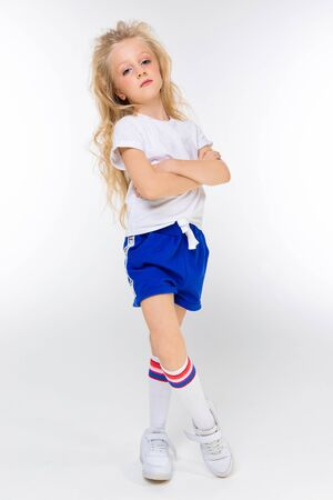 teenage girl in sportswear on a white background with copy space.