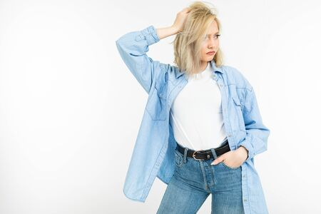 portrait of confident girl with blond haircut in casual style on white isolated background. Zdjęcie Seryjne