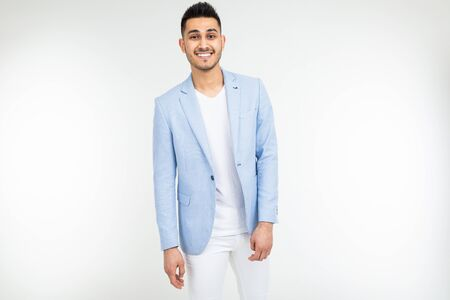 confident man in a blue jacket posing on a white background with copy space.