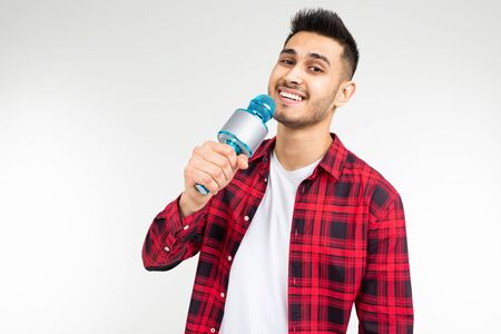 performer guy singer in a shirt with a microphone in his hands on a white background.