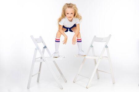 teenager girl in sports shorts on a white background. Zdjęcie Seryjne