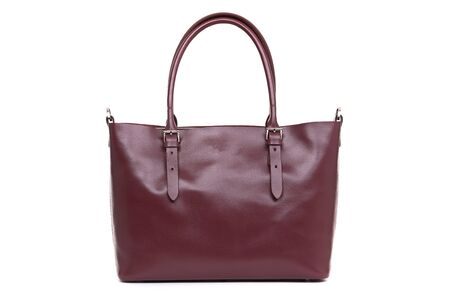 expensive red female leather bag on a handle isolated on a white background.