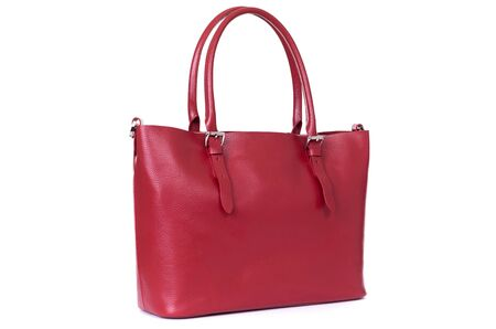 red leather hand made bag on a white background.
