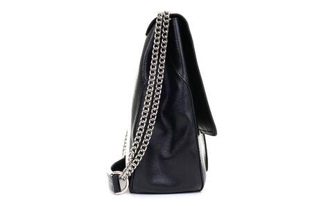 leather black female backpack sideways on a white background.